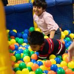 children have exercise and lots of fun in the giant ball pit